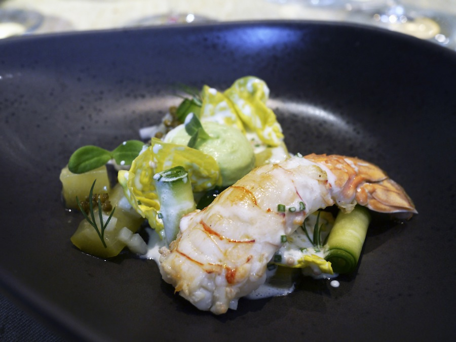 An enourmous langoustine with elderflower berries and variations of cucumber.